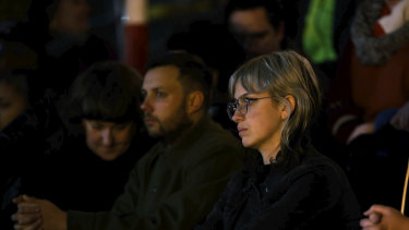 People attend a vigil for Natalina Angok at Parliament House, Melbourne, on Friday.