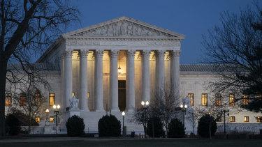 Night falls on the Supreme Court in Washington.