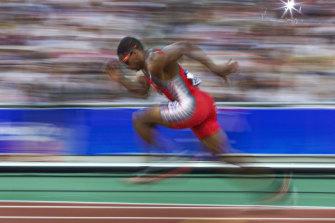 Ato Bolden runnning at the Sydney Olympics.