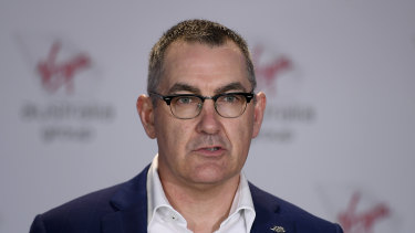 Virgin CEO Paul Scurrah, pictured in Brisbane on Wednesday, said he was trimming the airline back to its profitable parts.