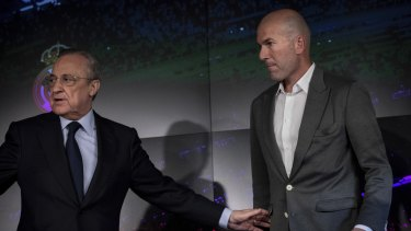 Zidane and club president Florentino Perez at the press conference on Tuesday.