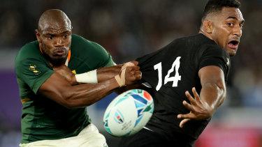 Sleight of hand: Sevu Reece throws a reverse pass against South Africa.