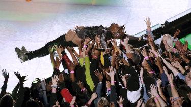 Travis Scott surfs the crowd.