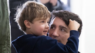 Canadian Prime Minister Justin Trudeau holds his son Hadrien as he waits to vote in Montreal last year.