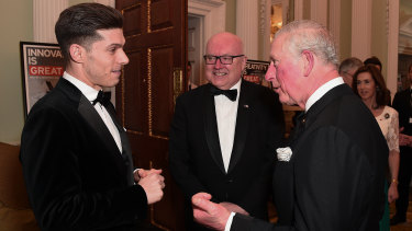 Prince Charles talks with Australian musical theatre star Josh Piterman and Australian High Commissioner George Brandis at the bushfire fundraiser.