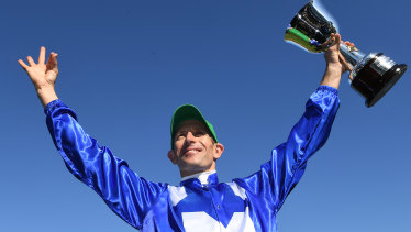 Star turn: Hugh Bowman salutes the crowd after his winning run in the Turnbull Stakes.