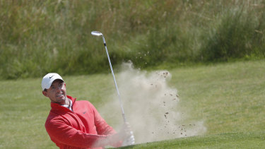 Northern Ireland's Rory McIlroy plays out of a bunker on the 6th green.