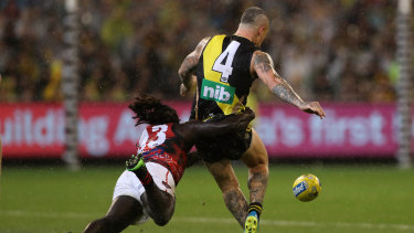 He's comin' to getcha: Anthony McDonald-Tipungwuti lays a rundown tackle on Dustin Martin.