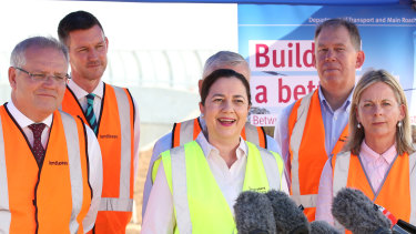 Left to right (front): Prime Minister Scott Morrison, Queensland Premier Annastacia Palaszczuk and Member for Moncrieff Angie Bell, at a construction site in Brisbane, where new infrastructure funding was announced on Wednesday.