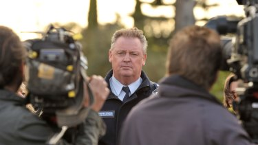 Stephen Mutton addresses media during the 44-hour siege with Christopher Binse.