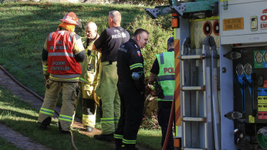 Emergency services respond to a fire that killed three people at the Everton Hills home.