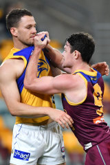 Brisbane's Lachie Neale tangles with Eagle Jack Redden.