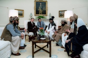 US president Ronald Reagan meets an Afghan delegation at the White House in 1983. While Reagan would later receive mujahideen leaders at the White House, only one of the Afghans seen here is a combatant - Mohammad Ghafoor Yousafzai, third from right.