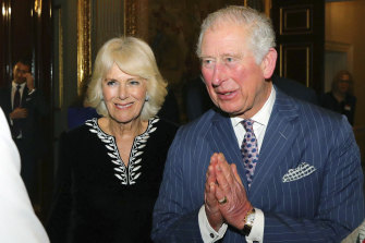 "Prince Charles using the ""namaste"" greeting."