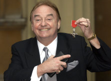 Gerry Marsden holds his MBE in 2003.