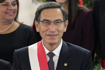 Peruvian President Martin Vizcarra smiles after the swearing-in ceremony of his new cabinet at the government palace in Lima last year.