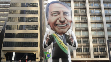 Supporters of Jair Bolsonaro, presidential candidate for the National Social Liberal Party who was stabbed during a campaign event, exhibit a large, inflatable doll in his image to show support for him, in Sao Paulo, Brazil.