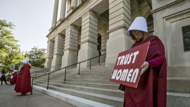 Michelle Disher and others dressed as characters from The Handmaid's Tale protest outside the Georgia Capitol.