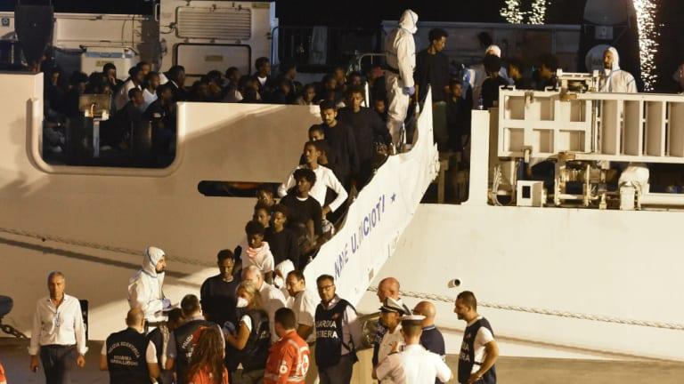 "Migrants disembark from the Italian Coast Guard ship ""Diciotti"" in the port of Catania, Italy, on Sunday."