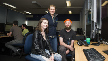 The Canberra Technology Park will be sold off to the Academy of Interactive Education for a redevelopment. AIE student Sian Sallway, AIE planning and implementation manager Casey Gregory, and AIE student Pop Jadric.