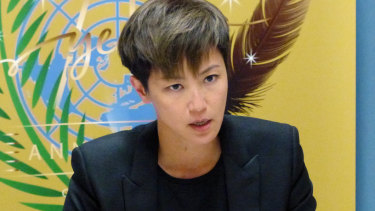 Hong Kong pop singer Denise Ho speaks out against China at the UN building in Geneva.