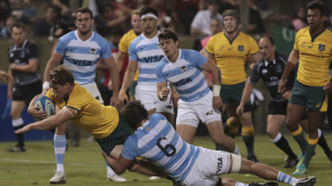 Turnaround: Wallabies captain Michael Hooper reaches for the try line.