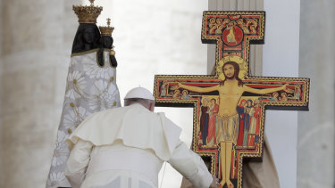 Pope Francis blesses a statue of the Virgin Mary and a crucifix that will be taken to Panama for the next World Youth Day, in St. Peter's Square on Sunday.