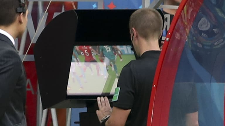 Still unclear: Referee Mark Geiger using VAR during this year's World Cup.