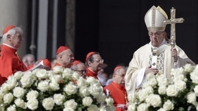 Pope Francis arrives to celebrate an Easter mass, in St Peter's square in Rome.