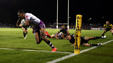 Josh Addo-Carr crosses for a Storm try in their humbling of the Panthers on Saturday.