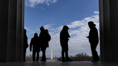 At a standstill: Visitors stand at the Lincoln Memorial.