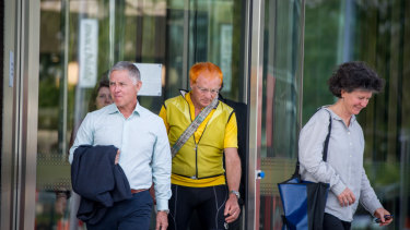 Pedal power members and supporters of Mike Hall leave the ACT courts after the inquest into Mr Hall's death was finalised.