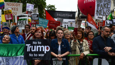 Protesters gather listen to Opposition Leader Jeremy Corbyn at an anti-Trump rally in London on Tuesday.