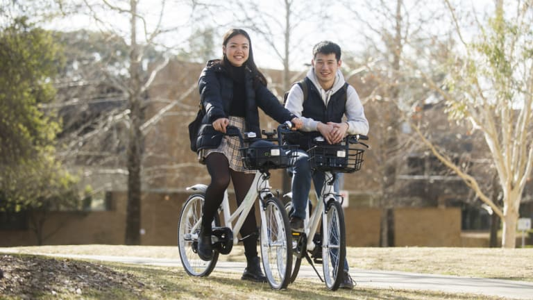 Lucy Xu and Michael Ma are some of the first users of Airbike in Canberra since it rolled out last week.