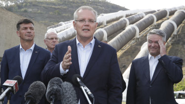 Minister for Energy Angus Taylor, Prime Minister Scott Morrison and Minister for Finance and the Public Service Mathias Cormann speak to the media during a visit to the Snowy Hyrdo Tumut 3 power station in Talbingo, NSW.