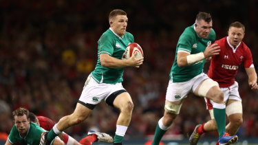Footloose: Ireland wing Andrew Conway makes a break at Principality Stadium.