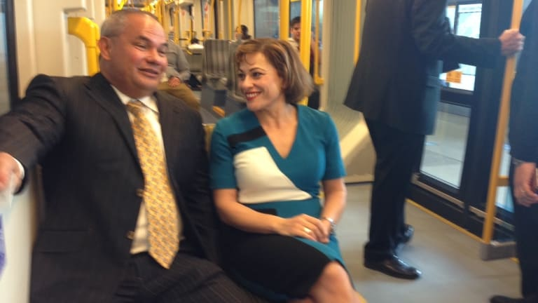 Gold Coast Mayor Tom Tate and Queensland Deputy Premier Jackie Trad take a ride on light rail.
