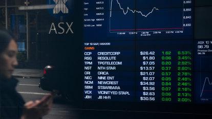 Stocks notch gains as bullish US sentiment helps offset profit warnings