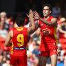 King kicks five as Suns thump Swans, raising tough questions for Sydney