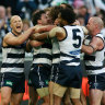 Geelong players mob Jimmy Bartel after his winning point in 2009.