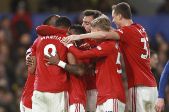 United players congratulate Anthony Martial after scoring his team's first goal.