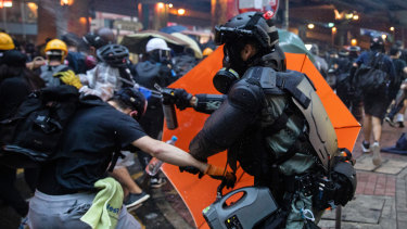 Riot police deploy pepper spray against demonstrators during a protest in the Admiralty district of Hong Kong in October.