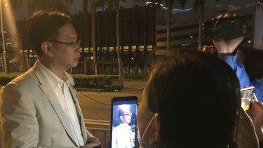 Ip Kin Yuen talks to distressed parents outside Polytechnic University cordon Tuesday evening.