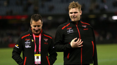 Sidelined: Injured defender Michael Hurley with Bombers coach John Worsfold.