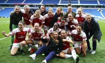 Arsenal players celebrate winning the FA Women's Super League at AMEX Stadium in Brighton on Sunday.