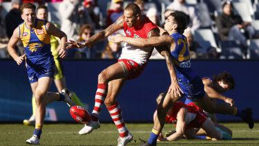 Lance Franklin takes a swing for goal against West Coast in Geelong.