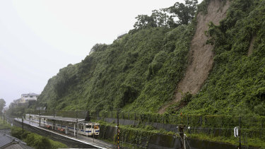 A landslide due to heavy rain is seen nearby a train station in Kagoshima City, south west of Japan.