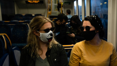 The NSW government is under increasing pressure to make masks mandatory on public transport.