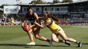 Darcy Vescio of the Blues, left, is tackled by Hannah Burchell of the Tigers during round four.