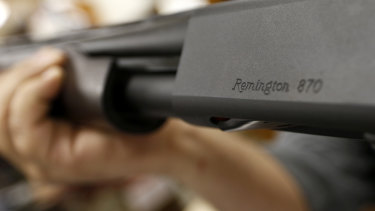 The Remington name is seen etched on a model 870 shotgun at Duke's Sport Shop in New Castle, Pennsylvania.